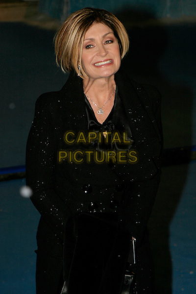 "SHARON OSBOURNE.""The Chronicles of Narnia: The Lion, The Witch & The Wardrobe"" - world premiere at the Royal Albert Hall, London, UK..December 7th, 2005.Ref: AH.half length black smiling.www.capitalpictures.com.sales@capitalpictures.com.©Capital Pictures"