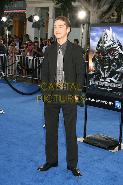 """SHIA LeBEOUF.""""Transformers"""" Los Angeles Premiere at Mann's Village Theatre, Westwood, California, USA..June 27th, 2007.full length labeouf black suit hands in pockets.CAP/ADM/RE.©Russ Elliot/AdMedia/Capital Pictures"""
