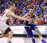 SIOUX FALLS, SD: MARCH 6: Michael Orris #50 of South Dakota State drives on Tyler Hagedorn #25 of South Dakota during the Summit League Basketball Championship on March 6, 2017 at the Denny Sanford Premier Center in Sioux Falls, SD. (Photo by Dick Carlson/Inertia)