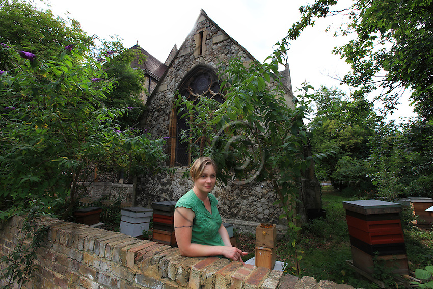 Camilla Goddart, 38 years old, posing in front of her first hive in the garden of St Peters Church in Brocley where she started 8 years ago. Since, this graphic designer by training created a company, &quot;Capital Bee&quot;, that sells honey in the markets or in shops and caf&Egrave;s like Broca Market, Brockley, The Frog on the Green Deli in Nunhead, Cafe Crema in New Cross and El's Kitchen in Ladywell. ? ????<br />