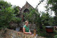 "Camilla Goddart, 38 years old, posing in front of her first hive in the garden of St Peters Church in Brocley where she started 8 years ago. Since, this graphic designer by training created a company, ""Capital Bee"", that sells honey in the markets or in shops and cafÈs like Broca Market, Brockley, The Frog on the Green Deli in Nunhead, Cafe Crema in New Cross and El's Kitchen in Ladywell. ? ????<br />