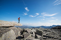 Female hiker on Cantilever stone, Glyder Fach, Snowdonia national park, Wales