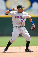 Shortstop Javier Castillo #20 of the Buffalo Bison makes a throw to first base at Knights Castle June 22, 2009 in Fort Mill, South Carolina. (Photo by Brian Westerholt / Four Seam Images)