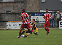 John Lowe (12) tackles with David Booth in the Huntly v Wigtown & Bladnoch William Hill Scottish Cup 1st Round match, at Christie Park, Huntly on 25.8.12.