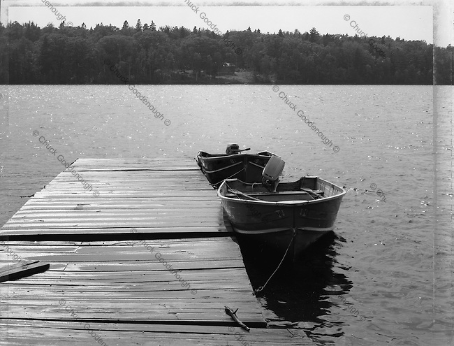 Black & White 4x5 Polaroid Photo of a fishing dock in Maine with boats just after a rain squall.