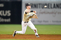 Wake Forest Demon Deacons second baseman Conor Keniry #14 makes a throw to first base against the Miami Hurricanes at NewBridge Bank Park on May 25, 2012 in Winston-Salem, North Carolina.  The Hurricanes defeated the Demon Deacons 6-3.  (Brian Westerholt/Four Seam Images)