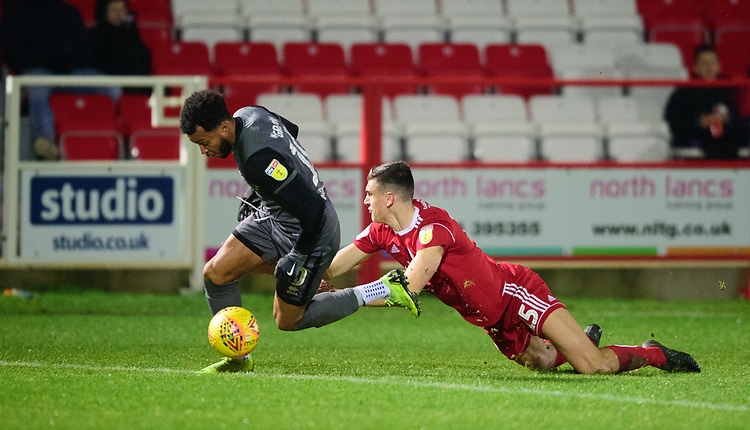 Lincoln City's Matt Green is fouled by Accrington Stanley's Ross Sykes<br /> <br /> Photographer Andrew Vaughan/CameraSport<br /> <br /> The EFL Checkatrade Trophy Second Round - Accrington Stanley v Lincoln City - Crown Ground - Accrington<br />  <br /> World Copyright &copy; 2018 CameraSport. All rights reserved. 43 Linden Ave. Countesthorpe. Leicester. England. LE8 5PG - Tel: +44 (0) 116 277 4147 - admin@camerasport.com - www.camerasport.com