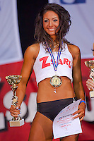 Competitor Rita Kovari winner of the under 165 cm category celebrates her victory during the Miss Zsaru (Miss Cop) contest in Budapest, Hungary on May 13, 2012. ATTILA VOLGYI