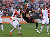 D.C. United forward Dwayne de Rosario (7) goes up to make a bicycle kick. D.C. United defeated Toronto FC 3-1 at RFK Stadium, Saturday May 19, 2012.