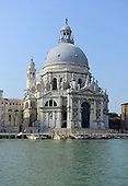 The Santa Maria della Salute a Baroque church that stands at the entrance of the Canal Grande (Grande Canal) in Venice, Italy on April 15, 2013.  Construction by Canal Grande (Grande Canal) was begun by Baldassare Longhena in 1630 in thanksgiving for the deliverance of Venice from the epidemic of 1630.  It was not completed until 1687. This view is looking across the canal from the Hotel Europa and Regina..Credit: Ron Sachs / CNP