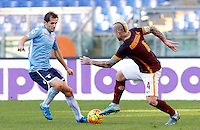 Calcio, Serie A: Roma vs Lazio. Roma, stadio Olimpico, 8 novembre 2015.<br /> Roma's Radja Nainggolan, right, is challenged by Lazio's Senad Lulic during the Italian Serie A football match between Roma and Lazio at Rome's Olympic stadium, 8 November 2015.<br /> UPDATE IMAGES PRESS/Riccardo De Luca