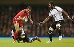 Fiji number 8 Masi Matadigo tackles Wales centre Jamie Roberts.<br /> Dove Men Series 2014<br /> Wales v Fiji<br /> Millennium Stadium<br /> 15.11.14<br /> ©Steve Pope-SPORTINGWALES
