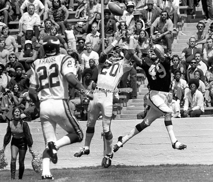 Oakland Raiders Mike Siani grabs pass over Minnesota Vikings Bobby Bryant and Paul Krause. <br />(photo 1973/Ron Riesterer)