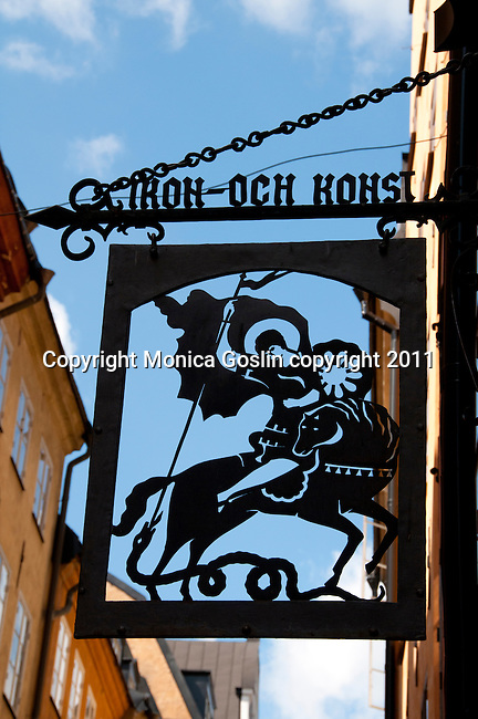 Sign for a store in Stockholm, Sweden with Saint George slaying the Dragon