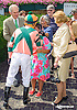 Kerwin Clark greets a fan in the winner's circle after Divine Excitement wins at Delaware Park on 7/11/15