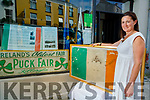 Clíodhna Foley with the flag her great grandmother made for the 1920 Puck fair and the puck crown from the same year.