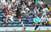 Bolton Wanderers' Harry Brockbank crosses as  Blackburn Rovers' Amari'i Bell looks on <br /> <br /> Photographer Andrew Kearns/CameraSport<br /> <br /> The EFL Sky Bet Championship - Blackburn Rovers v Bolton Wanderers - Monday 22nd April 2019 - Ewood Park - Blackburn<br /> <br /> World Copyright © 2019 CameraSport. All rights reserved. 43 Linden Ave. Countesthorpe. Leicester. England. LE8 5PG - Tel: +44 (0) 116 277 4147 - admin@camerasport.com - www.camerasport.com
