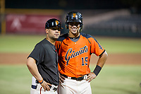 AZL Giants manager Hector Borg (13) and designated hitter Ricardo Genoves (15) pose for a photo during a game against the AZL Padres 2 on July 13, 2017 at Scottsdale Stadium in Scottsdale, Arizona. AZL Giants defeated the AZL Padres 2 11-3. (Zachary Lucy/Four Seam Images)