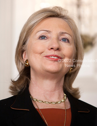 Hillary Rodham Clinton, U.S. secretary of state, stands during the announcement of Gary Locke, secretary of commerce, to be the next U.S. ambassador to China, at the White House in Washington, D.C., U.S., on Wednesday, March 9, 2011. If confirmed by the Senate, Locke would take over the diplomatic mission in a country that is a linchpin in Obama's trade policy..Credit: Joshua Roberts / Pool via CNP