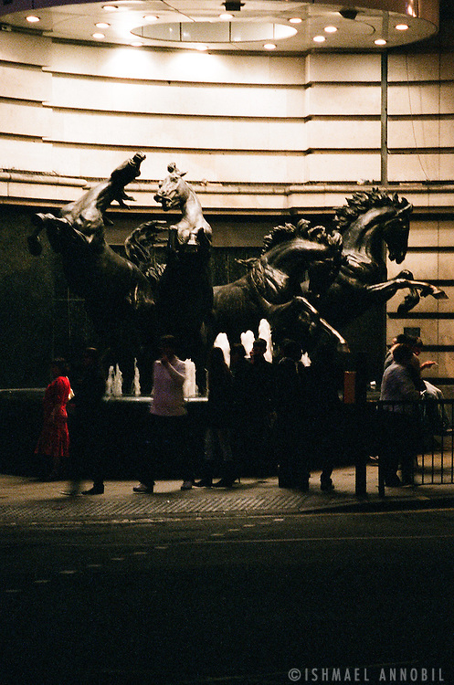 Bronze Horses and fountain of Piccadilly Circus at night