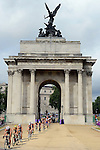 LONDON, ENGLAND - AUGUST 4:  General view of Spirig of Switzerland leading the peloton through Wellingtons Arch during the Women's Triathlon Final, Day 8 of the London 2012 Olympic Games on August 4, 2012 at the Hyde Park in London, England. (Photo by Donald Miralle)
