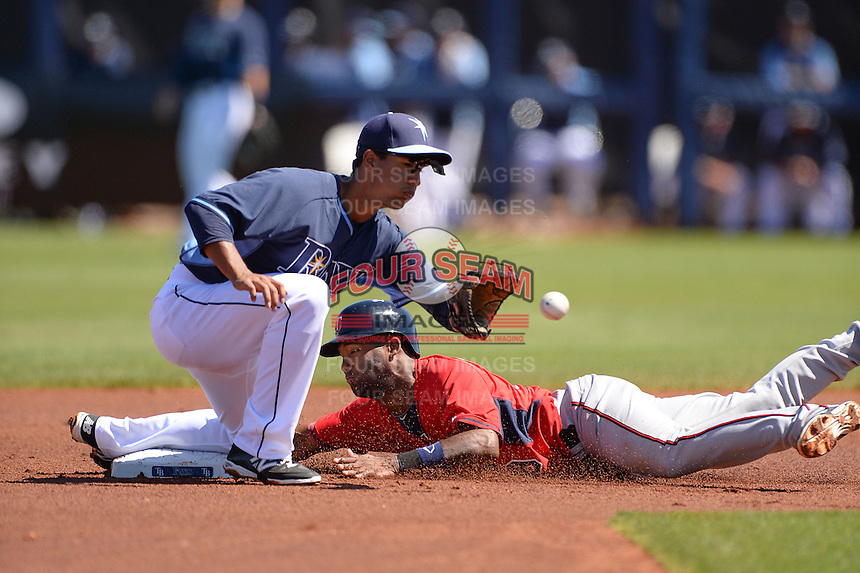 Tampa Bay Rays infielder Cole Figueroa (61) takes a throw as Danny Santana (39) slides in to second during a spring training game against the Minnesota Twins on March 2, 2014 at Charlotte Sports Park in Port Charlotte, Florida.  Tampa Bay defeated Minnesota 6-3.  (Mike Janes/Four Seam Images)