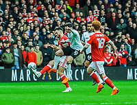 Nottingham Forest's forward Ben Brereton (17) beats Derby County's forward Tom Lawrence (10) to the ball during the Sky Bet Championship match between Nottingham Forest and Derby County at the City Ground, Nottingham, England on 10 March 2018. Photo by Stephen Buckley / PRiME Media Images.