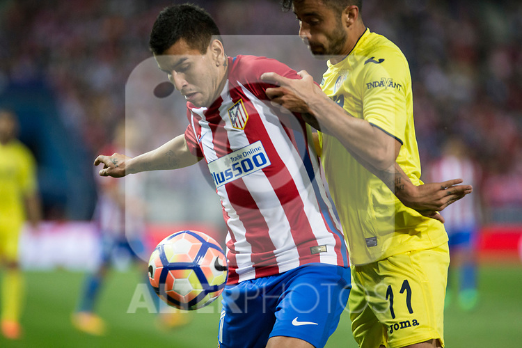 Angel Correa of Atletico de Madrid holds off pressure from  Jaume Costa of Villarreal during the match of La Liga between Atletico de Madrid and Villarreal at Vicente Calderon  Stadium  in Madrid, Spain. April 25, 2017. (ALTERPHOTOS/Rodrigo Jimenez)