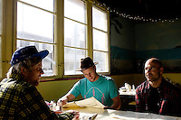 Venice, California, December 8, 2008 - (from left) Brothers Trace and Chad Marshall at breakfast with Rick Klotz at Cafe Venice. The trio created the clothing line, Warriors of Radness.
