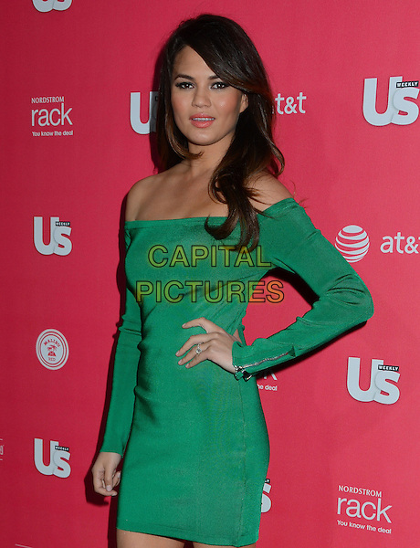 Chrissy Teigan.Us Weekly hosts annual Hot Hollywood Style issue celebrating 2013 fashionable style celebrities, Hollywood, California, USA, .18th April 2013..half length green off the shoulders hand on hip dress long sleeve .CAP/ADM/BT.©Birdie Thompson/AdMedia/Capital Pictures