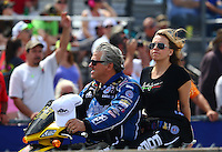Mar 13, 2015; Gainesville, FL, USA; NHRA funny car driver John Force (left) with daughter, top fuel driver Brittany Force during qualifying for the Gatornationals at Auto Plus Raceway at Gainesville. Mandatory Credit: Mark J. Rebilas-USA TODAY Sports