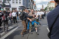 """Ueber 1.000 Rechtsextreme aus mehreren Bundeslaendern demonstrieren am Samstag den 19. August 2017 in Berlin zum Gedenken an den Hitler-Stellvertreter Rudolf Hess.<br /> Rudolf Hess hatte am 17. August 1987 im Alliierten Kriegsverbrechergefaengnis in Berlin Spandau Selbstmord begangen. Seitdem marschieren Rechtsextremisten am Wochenende nach dem Todestag mit sog. """"Hess-Maerschen"""".<br /> Weit ueber 1.000 Menschen protestierten gegen den Aufmarsch der Rechtsextremisten und stoppten den Hess-Marsch nach 300 Metern u.a. mit Sitzblockaden. Der rechtsextreme Aufmarsch wurde daraufhin von der Polizei umgeleitet.<br /> Aus dem Aufmarsch wurden mehrfach Gegendemonstranten angegriffen, mindestens ein Neonazi wurde festgenommen.<br /> Im Bild: Ein Rechtsextremer hindert einen Kameraden an weiteren Angriffen.<br /> 19.8.2017, Berlin<br /> Copyright: Christian-Ditsch.de<br /> [Inhaltsveraendernde Manipulation des Fotos nur nach ausdruecklicher Genehmigung des Fotografen. Vereinbarungen ueber Abtretung von Persoenlichkeitsrechten/Model Release der abgebildeten Person/Personen liegen nicht vor. NO MODEL RELEASE! Nur fuer Redaktionelle Zwecke. Don't publish without copyright Christian-Ditsch.de, Veroeffentlichung nur mit Fotografennennung, sowie gegen Honorar, MwSt. und Beleg. Konto: I N G - D i B a, IBAN DE58500105175400192269, BIC INGDDEFFXXX, Kontakt: post@christian-ditsch.de<br /> Bei der Bearbeitung der Dateiinformationen darf die Urheberkennzeichnung in den EXIF- und  IPTC-Daten nicht entfernt werden, diese sind in digitalen Medien nach §95c UrhG rechtlich geschuetzt. Der Urhebervermerk wird gemaess §13 UrhG verlangt.]"""
