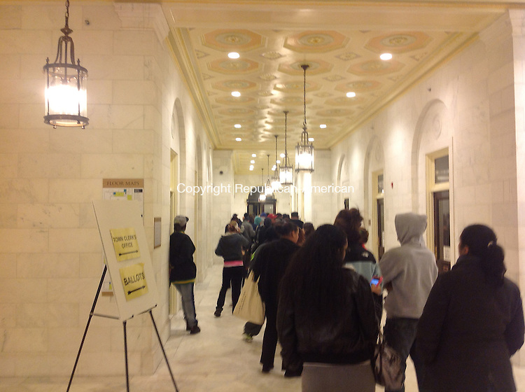 WATERBURY -- With just five minutes left to vote Tuesday, the line of people waiting to cast presidential ballots was more than 100 people deep at Waterbury City Hall.   Penelope Overton Republican-American