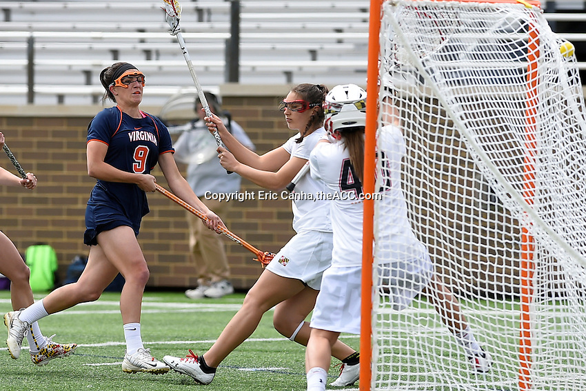 Virginia's Liza Blue (9) finds the back of Maryland's Abbey Clipp's (40) net  during the 2014 ACC Women's Lacrosse Semifinals in Boston, MA, Friday, April 25, 2014. (Photo by Eric Canha,<br /> theACC.com)