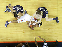 The referee watches as Virginia forward Sydney Umeri (44) struggles to gain control of a loose ball with Georgia Tech forward Katarina Vuckovic (10) and Georgia Tech guard/forward Aaliyah Whiteside (2) during the 68-62 loss to Georgia Tech Sunday in Charlottesville, Va. Photo/The Daily Progress/Andrew Shurtleff
