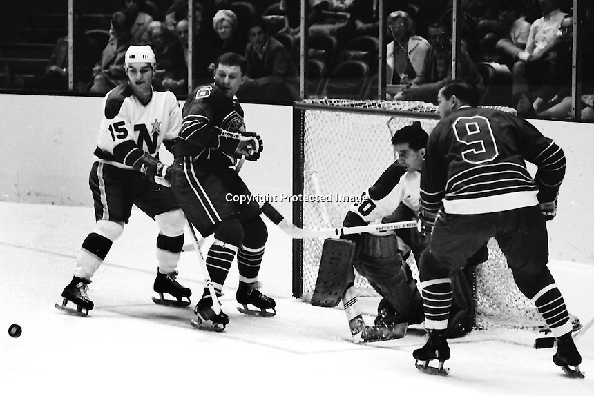 Seals vs Northstars: Stars #15 Andre Boudrias, and goalie Cesare Maniago, Seals #6 Wally Boyer and #9 Bill Hicke. (photo/Ron Riesterer)