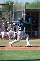 Milwaukee Brewers second baseman Daniel Castillo (65) follows through on his swing during an Instructional League game against the San Diego Padres at Peoria Sports Complex on September 21, 2018 in Peoria, Arizona. (Zachary Lucy/Four Seam Images)