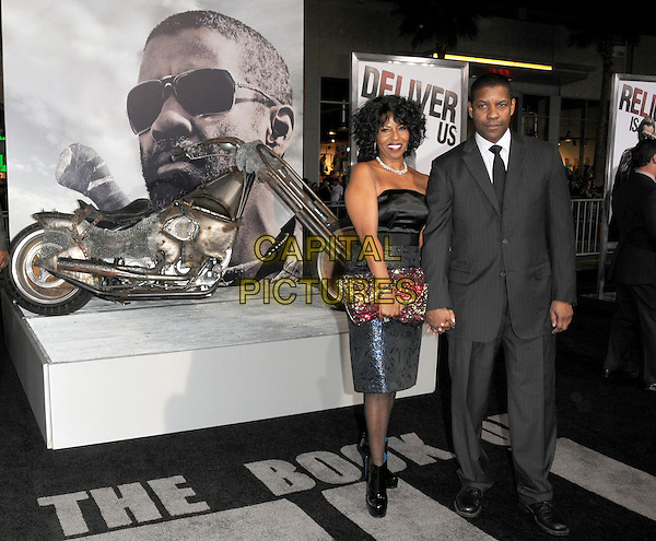 "PAULETTA & DENZEL WASHINGTON .at Alcon Entertainment's L.A. Premiere of ""The Book of Eli"" held at The Chinese Theatre in Hollywood, California, USA,  January 11th 2010..full length black and blue shiny dress grey gray suit tie married couple husband wife ankle boots patent clutch bag pink beaded red jewelled jewel encrusted pattern patterned bike motorcycle motorbike .CAP/RKE/DVS.©DVS/RockinExposures/Capital Pictures."