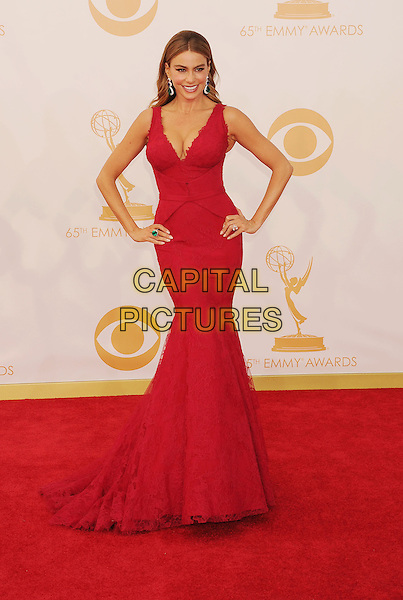 Sofia Vergara<br /> The 65th Annual Primetime Emmy Awards - Arrivals held at The Nokia Theatre L.A. Live in Los Angeles, California, USA.<br /> September 22nd, 2013<br /> full length red dress lace cleavage hands on hips viagra <br /> CAP/ROT/TM<br /> &copy;Tony Michaels/Roth Stock/Capital Pictures