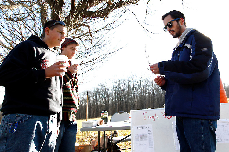 Southbury, CT- 30 November 2013-113013CM01- Steve Pendergast, 17, of Southbury and an Eagle Scout candidate, right, explains the various invasive species to volunteers Sebastiano Giardina, 17, and his brother Zachary Giardina, 16, of Southbury at Phillip's Farm in Southbury Saturday morning.   Pendergast was leading a group of volunteers who were removing invasive species and working on the fields at the farm.  The event was meant for Pendergast to show leadership and other qualities, which are required for completion of his Eagle Scout Service Project.    Christopher Massa Republican-American