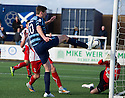 Forfar's Chris Templeman knocks the ball past the post.