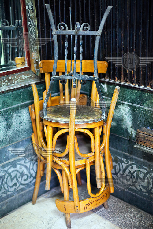 Chairs and a table piled up in a corner at the El Fishawi's Coffee house in Khan al-Khalili. /Felix Features