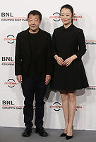 Il regista cinese Jia Zhangke (s) posa con l'attrice cinese Zhao Tao (d) durante un photocall alla 14^ Festa del Cinema di Roma all'Aufditorium Parco della Musica di Roma, 26 ottobre 2019.<br /> Chinese director Jia Zhangke (l) poses  with chinese actress Zhao Tao (r) for a photocall  during the 14^ Rome Film Fest at Rome's Auditorium, on 26 October 2019.<br /> UPDATE IMAGES PRESS/Isabella Bonotto
