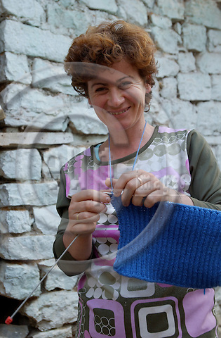 Lin-Pogradec-Albania - August 02, 2004---A  woman at/from the village of Lin knitting a woolen piece; region/village of project implementation by GTZ-Wiram-Albania (German Technical Cooperation, Deutsche Gesellschaft fuer Technische Zusammenarbeit (GTZ) GmbH); people-portrait---Photo: Horst Wagner/eup-images