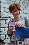 Lin-Pogradec-Albania - August 02, 2004---A  woman at/from the village of Lin knitting a woolen piece; region/village of project implementation by GTZ-Wiram-Albania (German Technical Cooperation, Deutsche Gesellschaft fuer Technische Zusammenarbeit (GTZ) GmbH); people-portrait---Photo: Horst Wagner/eup-images