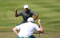 Tiger Woods (USA) and Rory McIlroy (NIR) line up their putts on the 2nd green during Saturday's Round 3 of the HSBC Golf Championship at the Abu Dhabi Golf Club, United Arab Emirates, 28th January 2012 (Photo Eoin Clarke/www.golffile.ie)