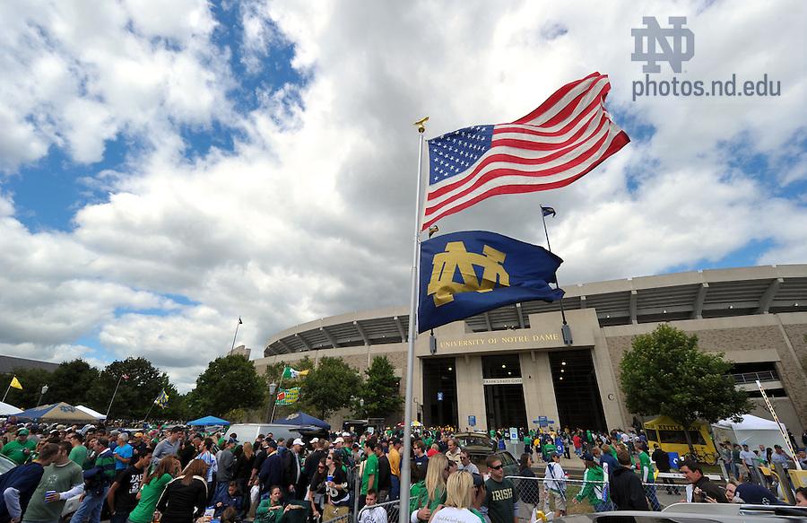 Fans tailgate outside ND Stadium on an unseasonably cool sesason-opener day...Photo by Matt Cashore