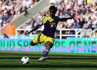 Pictured: Wilfried Bony of Swansea takes a shot at goal. Saturday 19 April 2014<br /> Re: Barclay's Premier League, Newcastle United v Swansea City FC at St James Park, Newcastle, UK.
