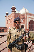 Agra, India.  Taj Mahal, Armed Security Guard.  Taj Mosque in the background.