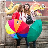 Nanjing, Jiangsu, China.  Young Chinese Women Taking a Selfie.